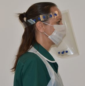 Profile view of Face Shield worn by care worker